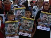بالصور: وقفة إسنادية دعما للأسرى المضربين عن الطعام وسط رام الله