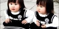 صينية تبيع نجليها التوأم من أجل هاتف محمول