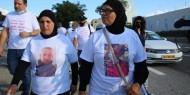 مظاهرة نسائية مطالبة بالتحقيق في جرائم القتل بالداخل المحتل