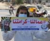بالصور   مجلس المرأة بخانيونس ينظم وقفة احتجاجية رفضا للتمييز الجغرافي ضد عمال غزة