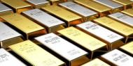 الدولار يقود صعود أسعار الذهب