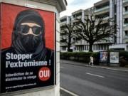 السويسريون يصوتون غدا على حظر النقاب