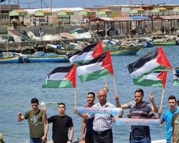 بالصور|| صيادو غزة يطالبون برفع الحصار البحري خلال وقفة احتجاجية