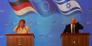 ميركل وبينيت يحذران من دخول العالم في مرحلة حاسمة بشأن ملف إيران النووي